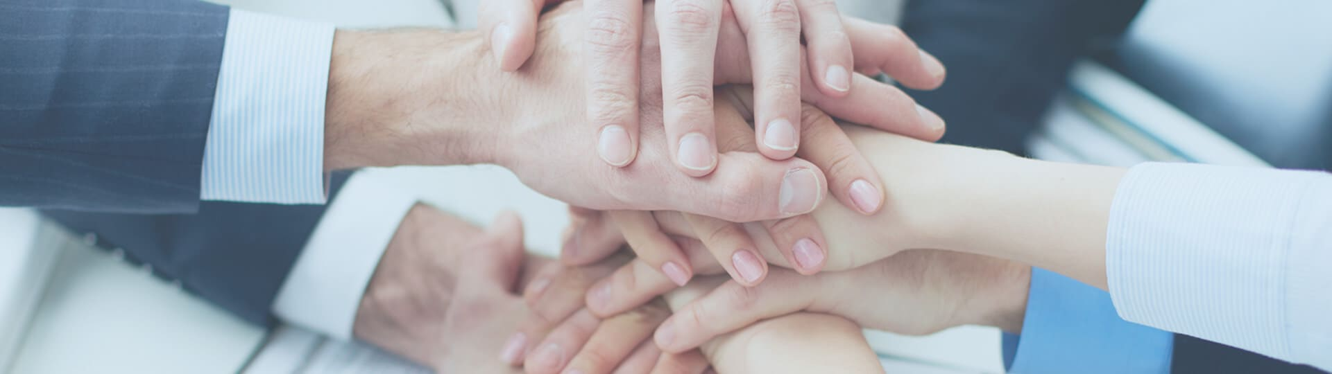 hands joining together, team collaboration